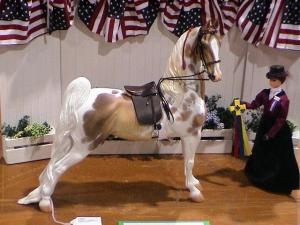 This model horse nicely shows absolute elevation, with an upright next, dropped shoulders and back, and outwardly turned hind end.